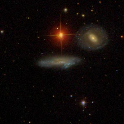 http://zooniverse-static.s3.amazonaws.com/www.galaxyzoo.org/subjects/standard/56f3e0a65925d9004300ae03.jpeg